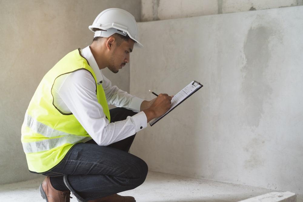 surveyor inspecting damp wall